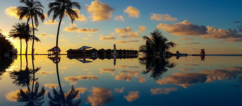 maldives-sunset-over-palm-trees