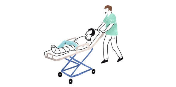 A doctor pushing a patient on a hospital bed
