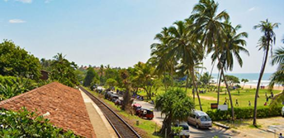 Railway running beside Sri Lankan Beach