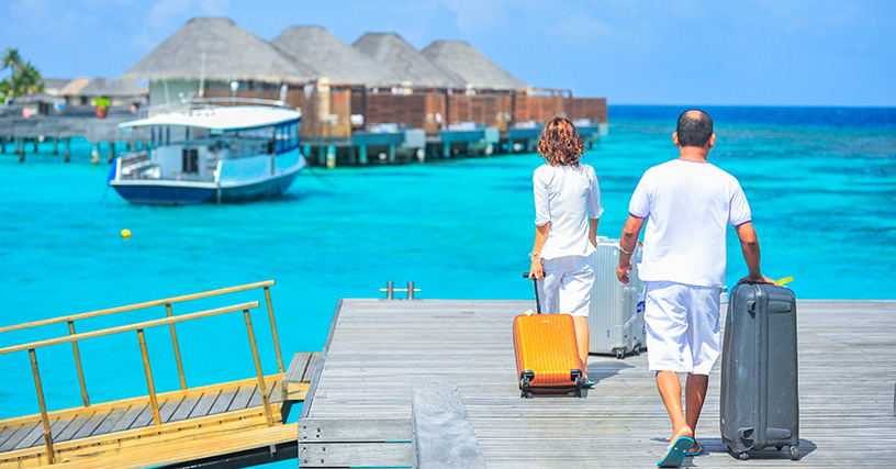 travellers with suitcases in maldives